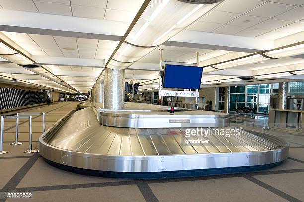 empty airport baggage carousel - baggage claim stock pictures, royalty-free photos & images