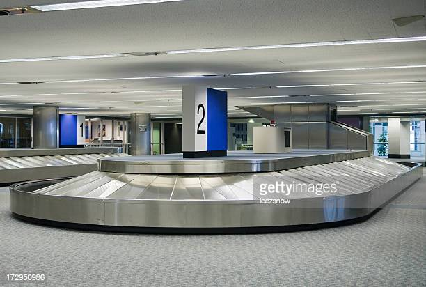 empty airport baggage claim carousel - baggage claim stock pictures, royalty-free photos & images