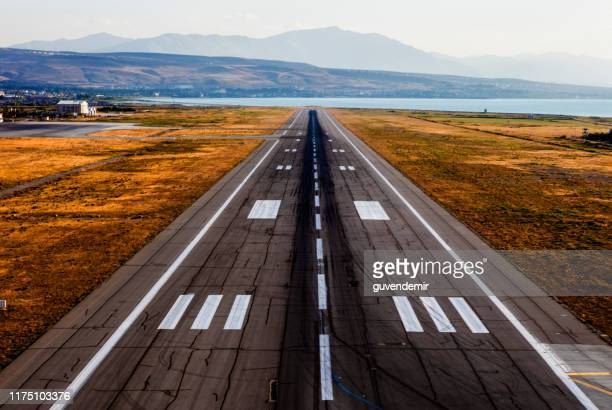 empty airport runway - taxiway stock pictures, royalty-free photos & images