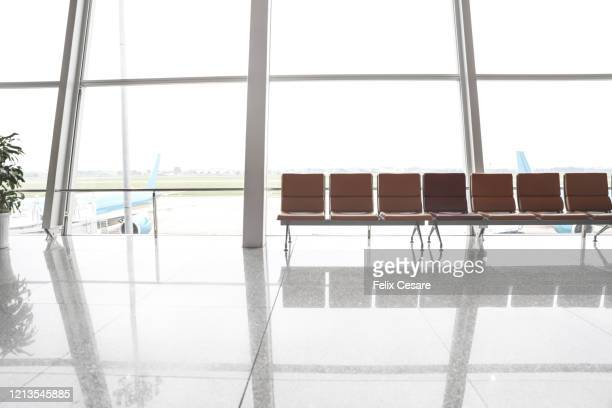 empty airport terminal - travel ban stock pictures, royalty-free photos & images