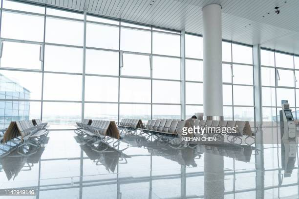 empty airport terminal waiting area - airport stock pictures, royalty-free photos & images