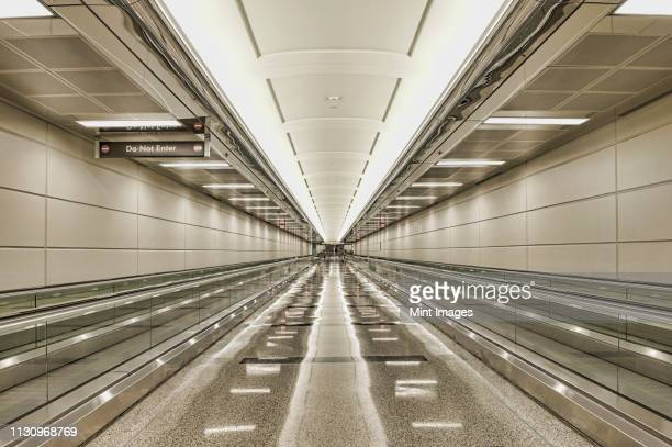 empty airport walkway - arlington virginia stock pictures, royalty-free photos & images
