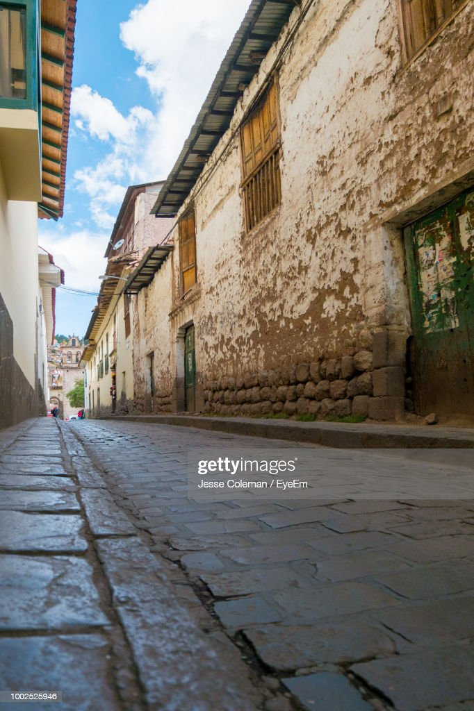 Empty Alley Amidst Buildings In City : Stock Photo