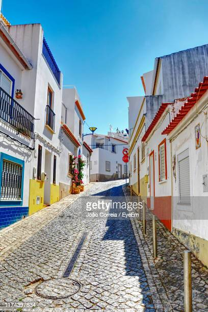 empty alley amidst buildings in city - faro district portugal stock pictures, royalty-free photos & images