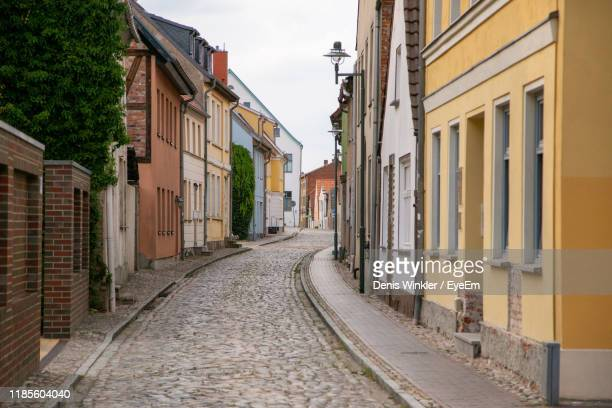 empty alley amidst buildings in city - mecklenburg vorpommern stock pictures, royalty-free photos & images