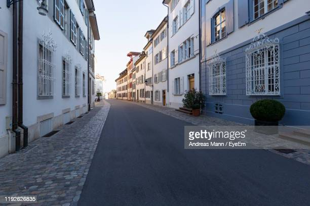empty alley amidst buildings in city - basel switzerland stock pictures, royalty-free photos & images