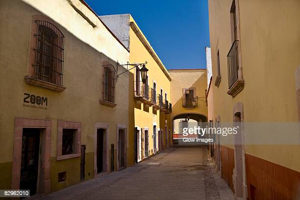 empty alley in a city, callejon de veyna, zacatecas, zacatecas state, mexico - callejon stock pictures, royalty-free photos & images