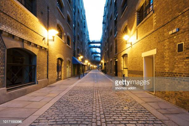 empty alleyway of london at twilight - alley stock photos and pictures