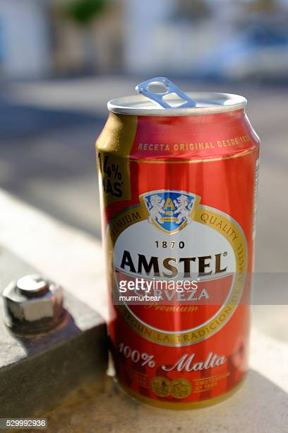 empty amstel beer can left in the street.