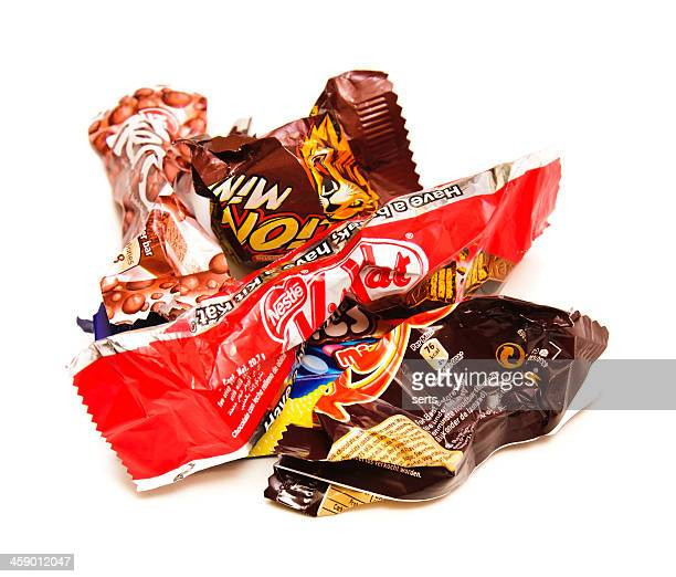 Empty and crumpled candy bars