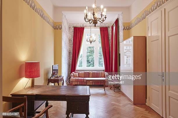 Empty apartment with antique furniture