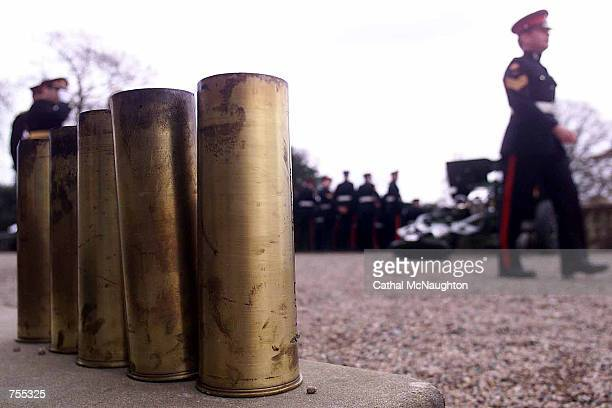 Empty artillery shells are collected and counted after members of the 206 Ulstery Battery Royal Artillery fired a 41 gun salute April 1 2002 at...