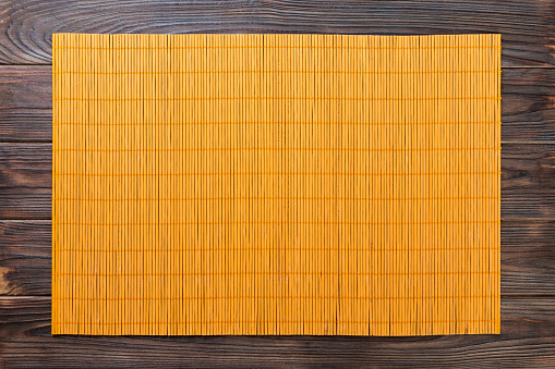 Empty Asian Food Background. Yellow Bamboo mat on wooden background top view with copy space flat lay 1162351040