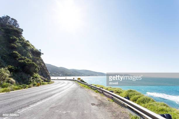 empty asphalt road and beautiful sea in blue sky