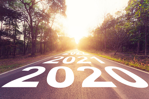 Empty asphalt road and New year 2020 concept. Driving on an empty road to Goals 2020. 1153470133