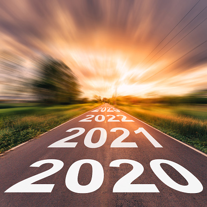 Empty asphalt road and New year 2020 concept. Driving on an empty road to Goals 2020. 1154808346