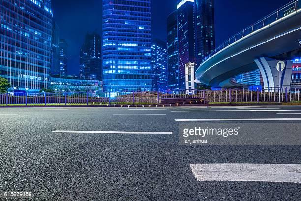 empty asphalt road through modern city.