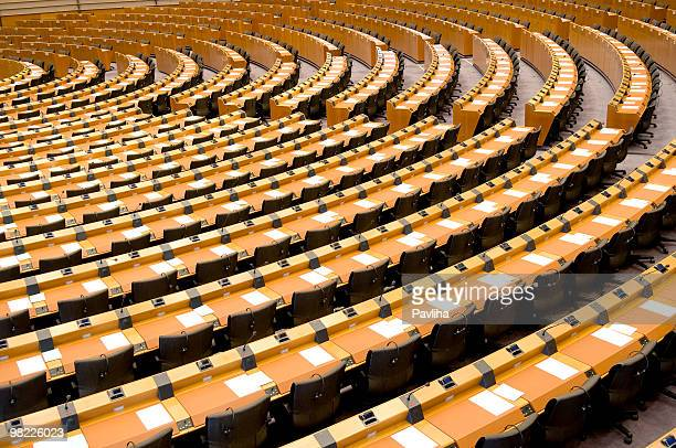 empty assembly room seat of european parliament brussels - democratie stockfoto's en -beelden