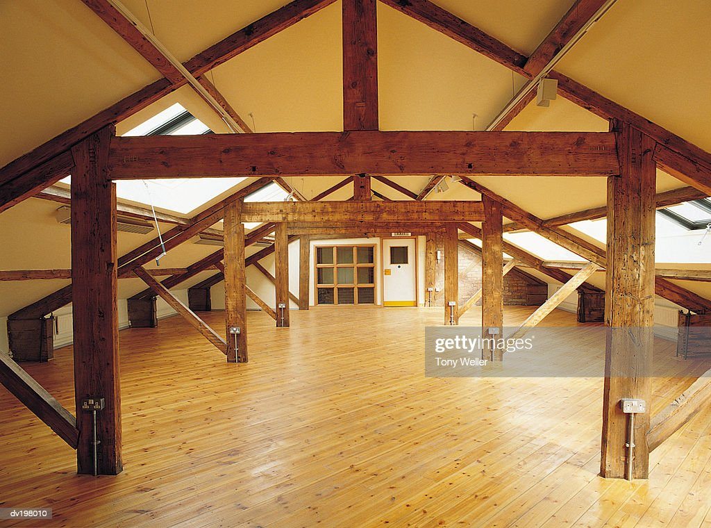 Empty attic with hardwood floors : Stock Photo