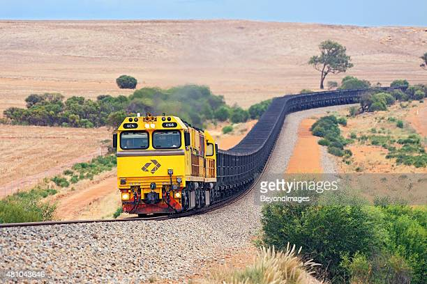 empty aurizon/karara magnetite iron ore train in hills - rail freight stock pictures, royalty-free photos & images