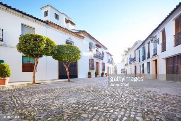 empty backroad in spanish town, ronda, spain - town stock pictures, royalty-free photos & images