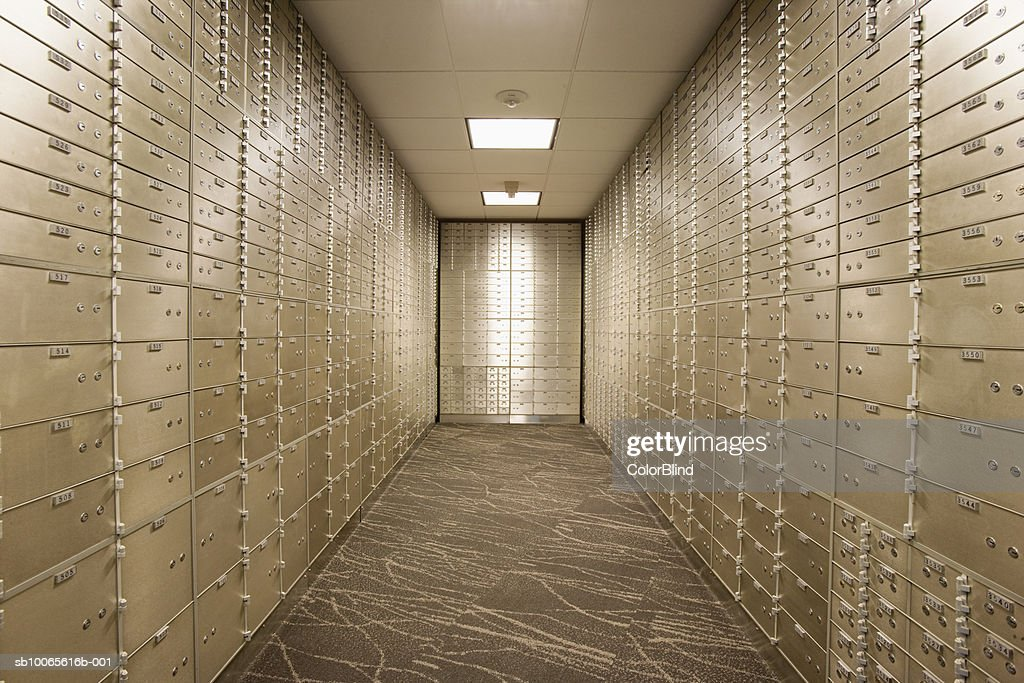 Empty bank vault with safety deposit boxes : Stock Photo