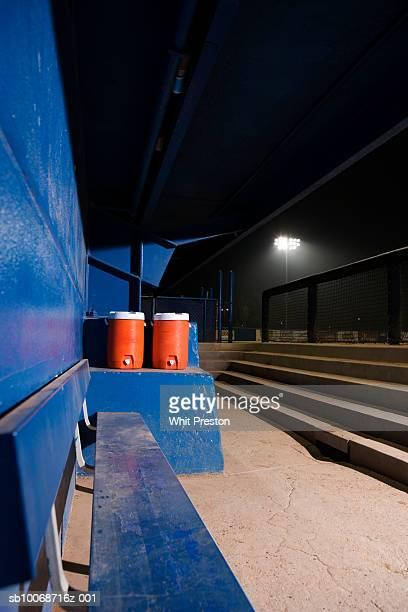 empty baseball dugout with water coolers - ダグアウト ストックフォトと画像