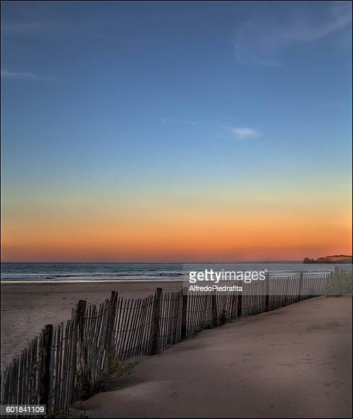 empty beach at sunset, hendaya, aquitaine, france - aquitaine stock photos and pictures