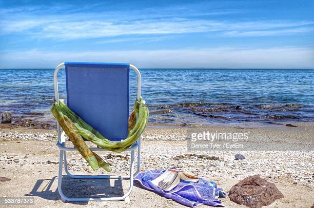 Empty Beach Chair Facing Sea