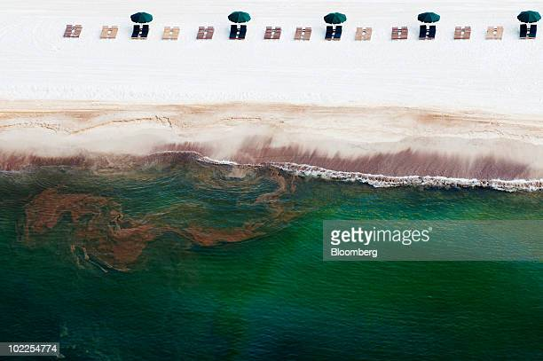 Empty beach chairs rest on the sand as oil washes ashore in Orange Beach Alabama US on Saturday June 19 2010 The BP Plc oil spill which began when...