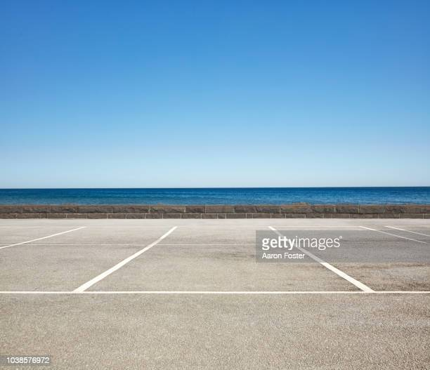 empty beach front parking lot - horizon over land stock pictures, royalty-free photos & images