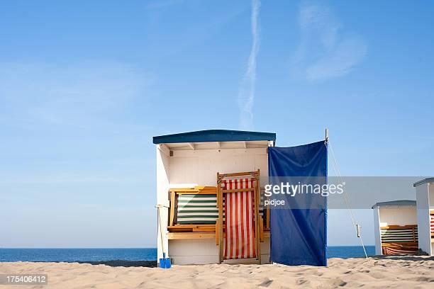empty beach huts at sunrise