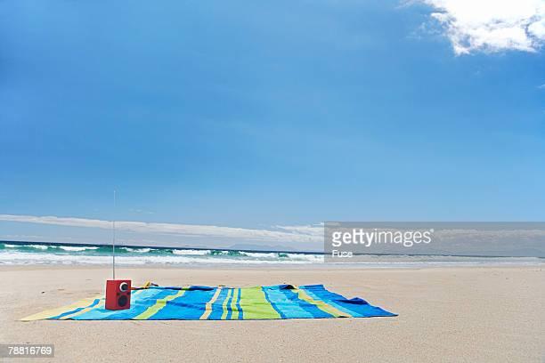 Empty Beach Towel by Ocean