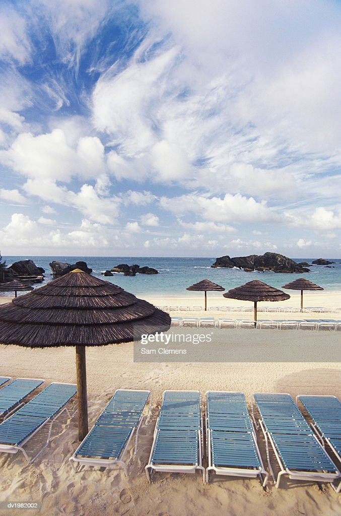 Empty Beach With Sun Loungers and Palapas : Stock Photo