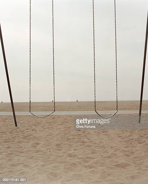 Empty beach with swings