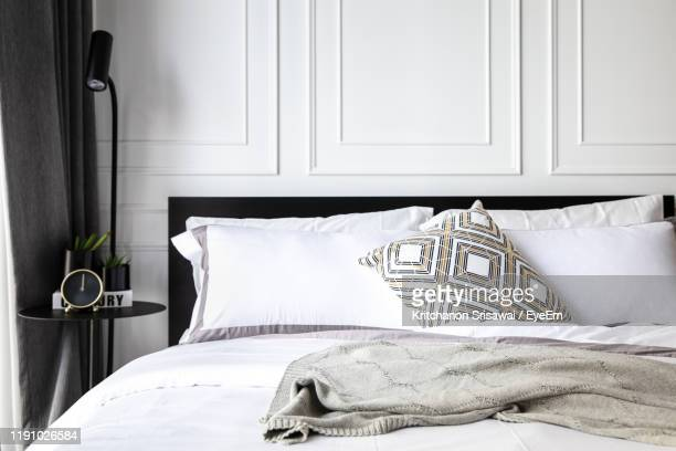 empty bed at home - bedroom stock pictures, royalty-free photos & images