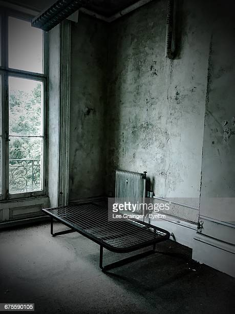 empty bed in old home - run down stock pictures, royalty-free photos & images