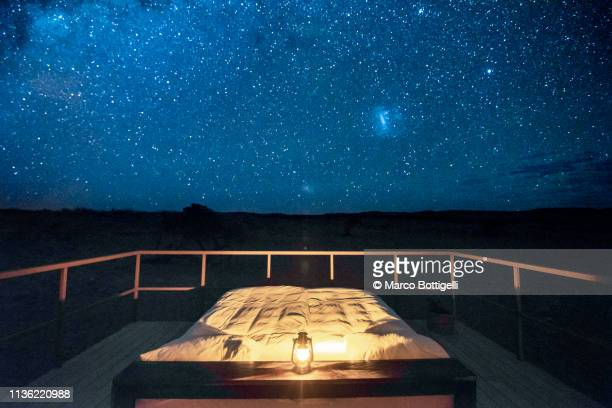 empty bed outdoor on a starry night - double bed stock pictures, royalty-free photos & images