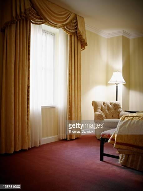 Empty bedroom in hotel suite