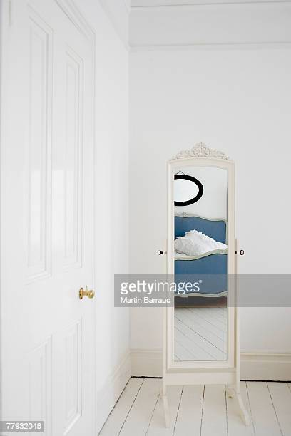 empty bedroom with mirror and bed - full length mirror stock photos and pictures