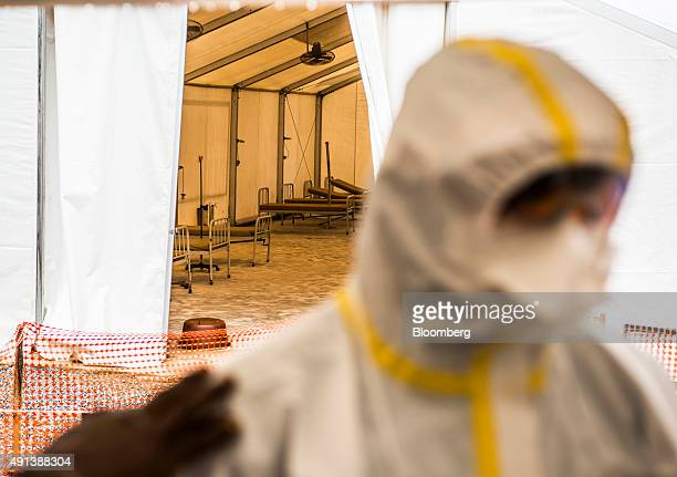 Empty beds for patients sit in a tent at an Ebola Treatment Center in Coyah Guinea on Thursday Sept 10 2015 An Ebola epidemic and a slump in...