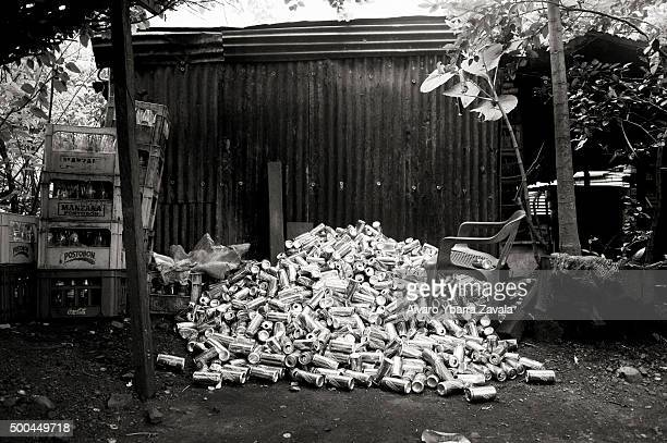 Empty beer cans after a party for members of 'los Pajaros' During the golden age emerald mining in the area all the bars and brothels were full Since...
