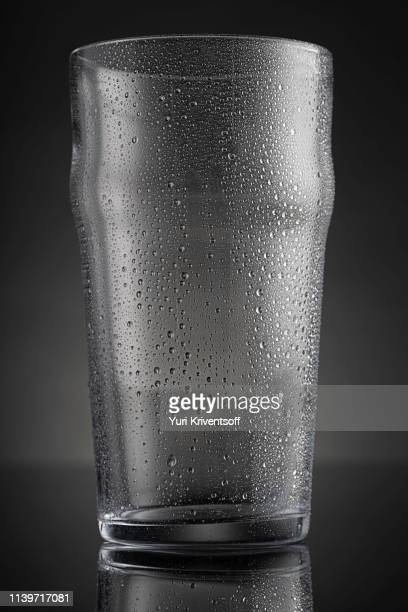 empty beer glass with condensation - condensation stock pictures, royalty-free photos & images