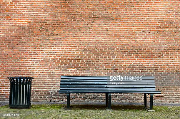 empty bench and garbage bin - garbage can stock photos and pictures