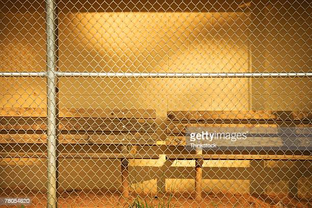 empty bench in baseball dugout - sports dugout stock pictures, royalty-free photos & images