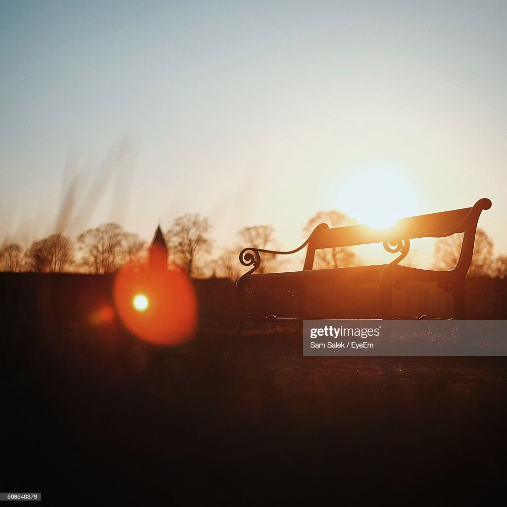 Empty Bench In Park During Sunset : Stock Photo