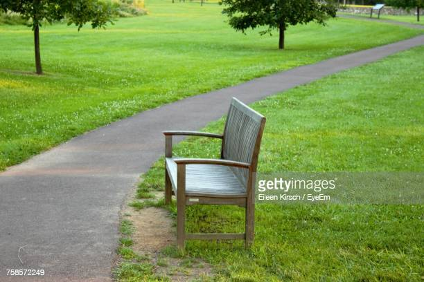 empty bench in park - eileen kirsch stock pictures, royalty-free photos & images