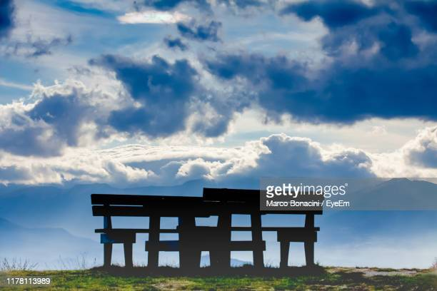 empty bench on field against sky - reggio emilia stock pictures, royalty-free photos & images