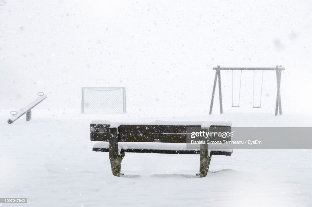 Empty Bench On Snow Covered Park During Winter : Stock Photo