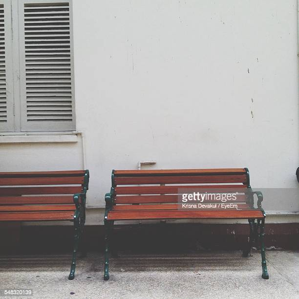Empty Benches Against The Wall